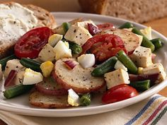 Potato-Tomato-Tofu Dinner-- quick and easy, I can always substitute the tofu for real meat, I'm sure chicken would go just fine with this dish