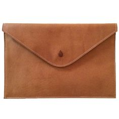 This leather clutch, along with all other products by Red Dirt Shop provides one year of safe water through Water.org.