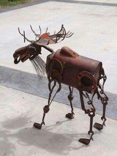 Rusty metal garden moose.