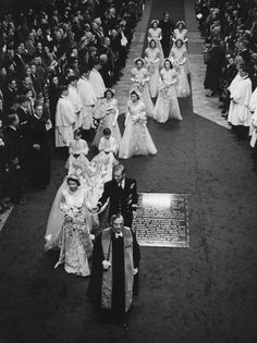 Princess Elizabeth and Prince Philip in the aisle of Westminster Abbey with their bridesmaids and pages, November 20, 1947.