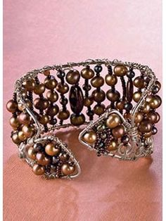 A silver pearl cuff I did. Perfect for fall, gonna have to bring it out soon. yay for beads!