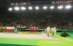 Russia is flanked by Spain, left, and Bulgaria after winning gold in the rhythmic gymnastics group all-around final during the Rio 2016 Summer Olympic Games at Rio Olympic Arena.    -  Best images from Aug. 21 at the Rio Olympics