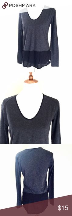 """Zara W&B collection gray black layered shirt S Cool basic top by Zara. Dark gray with a faux layer of black blouse underneath has a hi low effect. Long sleeves. Size small. Measures approx 18"""" across the bust and 24.5"""" long in the front and 29"""" in the back. In gently pre owned condition. Zara Tops Tees - Long Sleeve"""