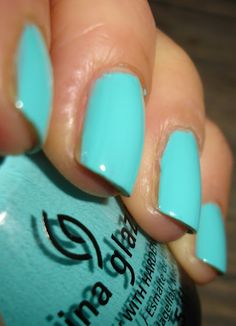 """China Glaze - """"Aquadelic"""" almost """"Tiffany blue"""" :) side note: the girls nails in this picture are not painted well and you can see the nasty brown fungus growing... Gross! But I love the color"""