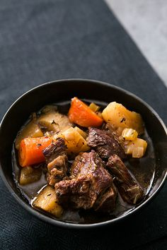 Savory beef stew with chuck beef roast, root vegetables and Guinness Extra Stout, cooked low and slow in a slow cooker. On SimplyRecipes.com