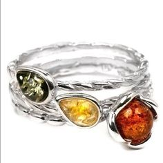 HP Sterling silver Baltic Amber stack rings Beautiful sterling silver, stamped 925, Baltic Sea area Amber stack rings, size 6.  So pretty! 3 separate rings; one with a flower and two with leaf shaped settings.  So lovely and dainty!  NWOT.  Host Pick 4/1/16 Best in jewelry & accessories party!  Thank you!!! ❤️❤️❤️ Jewelry Rings