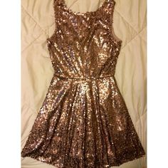 Gold Sequence Sleeveless Dress Gold Sequence Sleeveless Dress. Falls right above or around the knee. Size medium. Worn one night for a few hours. High neckline and v in back. Dress is a dusty gold - see last picture for a better idea of color. loveFIRE Dresses Mini