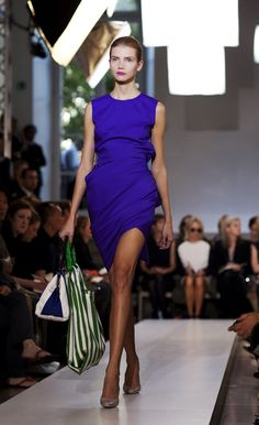 rich royal purple complemented by green striped bag. magenta lips