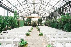 wedding ceremony setup - photo by Kelly Sweet Photography http://ruffledblog.com/botanical-garden-wedding-with-glass-ceilings