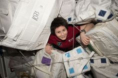 https://flic.kr/p/sqrahU | iss043e159309 | ISS043E159309 (05/04/2015) --- ESA (European Space Agency) astronaut Samantha Cristoforetti glides through supply containers packed onboard the International Space Station.
