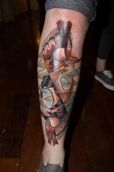 Abstract style colored leg tattoo of Indian faceless woman with house .