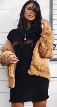 winter outfit idea : fur jacket and black sweatshirt dress