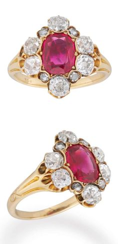 Victorian Burma Ruby and Diamond Ring, A Late Victorian ruby and diamond cluster ring, the oval faceted ruby weighing approximately 2 carats, yellow claw-set to the centre of a cluster surround of ten old brilliant-cut and rose-cut diamonds, estimated to weigh a total of 1.7 carats, all claw-set to a yellow gold mount and tapered shank with fluted shoulders, stamped '18ct', circa 1870.