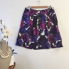 Michael Kors Skirt 💯 authentic Michael Kors skirt made of 100%silk. Slimming pleated a-line skirt with side pockets featuring big purple, plum, violet, and black flowers. Length: 22inches. Waist: 29.5inches MICHAEL Michael Kors Skirts