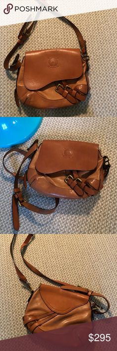 """Ralph Lauren Saddle Bag Beautiful unique bag! 100% Leather! Some wearing here and there! 10""""L x 9""""H x 3""""W! Comes with dust bag! No trades kindly make an offer! Ralph Lauren Bags Crossbody Bags"""