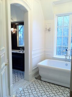 Quatrefoil with dark grout!  LOVE this floor for a bathroom.