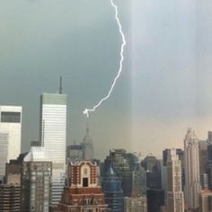 Lightning strike atop Empire State Building #NYC 6/22/12