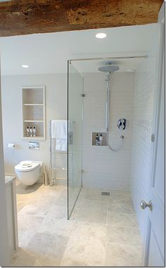 perfect renovated bath with walk in shower - notice beam above