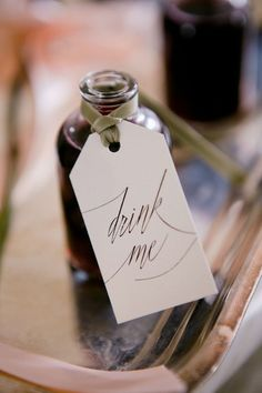drink me favors with a calligraphy tag