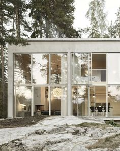 Positioned on the Swedish coastline, this concrete house by Arrhov Frick features a glazed facade which allows glimpses of the Baltic sea through the trees. Exterior Design, Interior And Exterior, Exterior Tradicional, Sweden House, Woodland House, Forest House, Weekend House, Aarhus, House In The Woods
