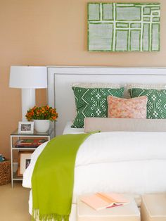 The graphic-print pillow and wall art add unique style to this cheery bedroom. More real-life bedrooms: http://www.bhg.com/rooms/bedroom/master-bedroom/25-of-our-favorite-real-life-bedrooms-/?socsrc=bhgpin062613greenpillows=19