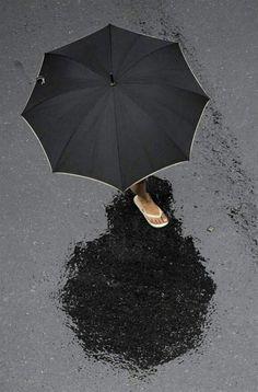 Black unbrella, rain, blacktop - by Juan Mabromata