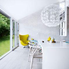 Living room - White painted floorboards, egg chair, Ikea light on www.designloversblog.com