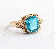 Vintage 10k Yellow Teal Blue Glass Stone Ring - 1940s Size 7 1/4 Emerald Cut Simulated Gemstone with Rose Flower Shoulders by Maejean Vintage on Etsy, $195.00