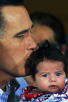 Republican presidential candidate Mitt Romney gave a baby a kiss while campaigning at Birmingham, Ala.  baby doesn't look happy!