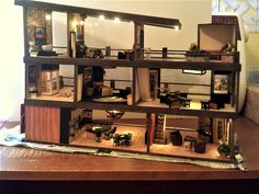 quarter-scale dollhouse Modern Dollhouse, Dollhouses, Liquor Cabinet, Scale, Storage, Furniture, Home Decor, Weighing Scale, Purse Storage