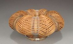 Carol Hetzel :  She started adding metal to her hand-dyed woven reed baskets, adding new dimension to the simple forms and rich colors.
