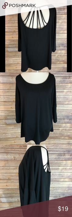 Maurices In Motion Plus Size 3 New with tags Maurices in motion plus size 3 black top. This has a very cute caged back to it. I paired it up with a sports bra I also have available in my closet. Smoke-free home Maurices Tops
