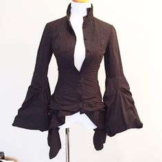 """AllSaints Spitalfields Steampunk Blouse AllSaints black blouse. This is a re-Posh because I just needed it for Halloween. It is a perfect piece for a steampunk costume. Button-down blouse with a stand-up collar, flared/bell sleeves, and a bustle in the back. It is a gorgeous top. UK 6, US 2, but I listed it as a US 0 because this blouse runs small, even for AllSaints. Shell: 100% cotton. Meshing (to give sleeves shape): 100% nylon. 22"""" to shortest part of hem, 30"""" to longest. 24"""" sleeves…"""