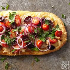 Start with refrigerated dough and add tapenade (or bruschetta or even hummus!), tomatoes, olives, onion, and cheese for a Mediterranean take on pizza.