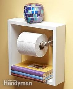 Place shadowbox frame around toilet paper holder so you can place books underneath the roller.