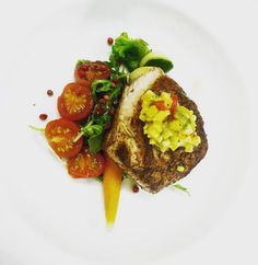 Oan seared wahoo filet, arugulas, baked tomatos and crudo dressing, pink peppercorns and mango salsa (from Kitchen 218, Turks & Caicos)