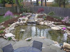 Beautiful! This is the design I would pick, I would just fill in around the pond more with my personal favorite flowers! <3 it!