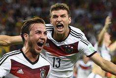 Germany's Mario Goetze celebrates his goal against Argentina infront of teammate Thomas Mueller during extra time in their 2014 World Cup final at the Maracana stadium in Rio de Janeiro July 13, 2014