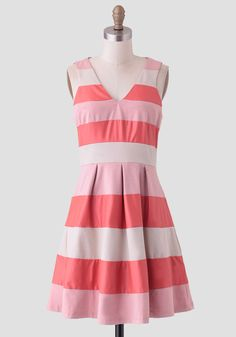 Adorable and vibrant, this fit-and-flare dress is designed with striped panels.