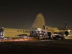 Loading a 1/3 Emirates A380 scale model onto An-124 at Ontario - Polet An-124 freighter - wikimedia
