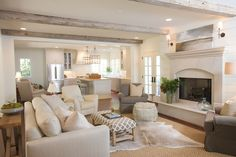 This dreamy living area that is open to the kitchen. Also love the beams