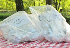 Packing Tinfoil dinners for camping. Make them before you go and freeze them. Then cook them on coals.