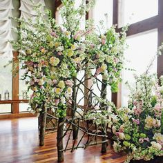 Stunning custom floral arch made with pink, white & green blooms and tree branches // Arch: John Lupton + Andrew Thomas // Jasmine Star Photography
