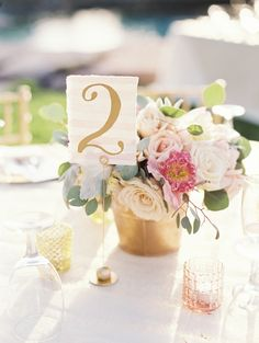 #table-numbers, #centerpiece Photography: Laura Gordon Photography - www.lauragordonphotography.com Read More: http://www.stylemepretty.com/2014/07/18/backyard-garden-wedding-in-northern-california/
