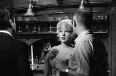 Marilyn with director Billy Wilder and Tony Curtis on the set of Some Like It Hot, 1958.