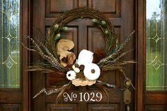 White Pumpkins Wreath Idea created with spray paint. You can pick up pumpkins at Goodwill, thrift stores or Hobby Lobby. Spray paint them and use them for the door.
