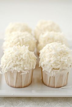 Get Coconut Cupcakes Recipe from Food Network Coconut Cupcakes, Yummy Cupcakes, Mini Cupcakes, White Cupcakes, Coconut Muffins, Cheesecake Cupcakes, Pretty Cupcakes, Vanilla Cupcakes, Mojito Cheesecake