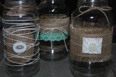 Recycled Jars with Burlap and Lace...Great wedding decorations.
