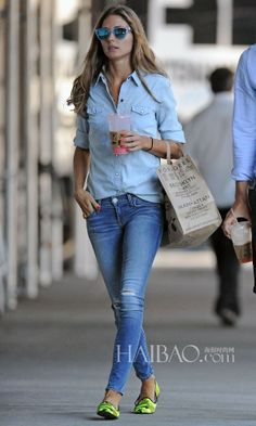 Olivia Palermo rocks a light wash denim button down shirt, blue denim skinny jeans, Faye Fluo Yellow Camoflage loafers, and Westward Leaning N•9.2 Sunglasses.