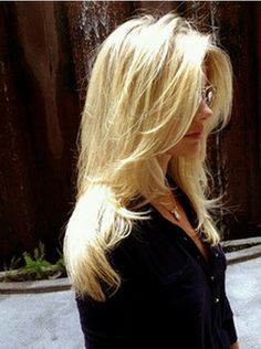 The Messy Styled Long Layered Hairstyle with Side Bangs for Long Blond Straight Hair